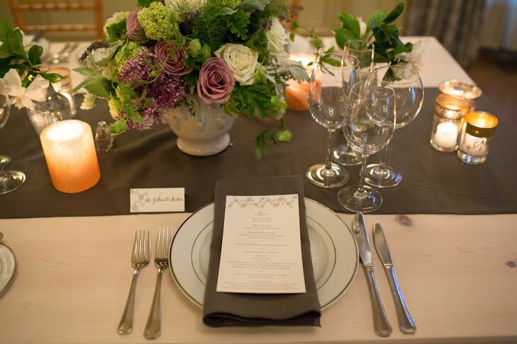 Slate table runners with matching napkins and simple stemware added a refined touch to the elegant tablescapes.