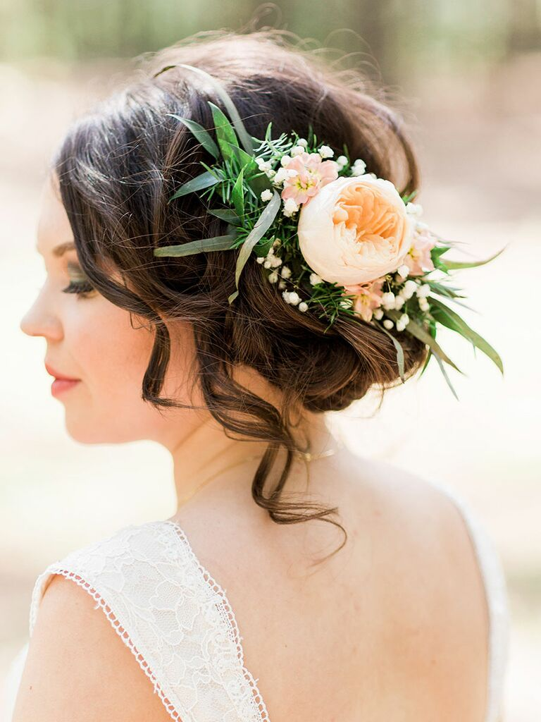 Bride with an easy updo adorned with flowers.