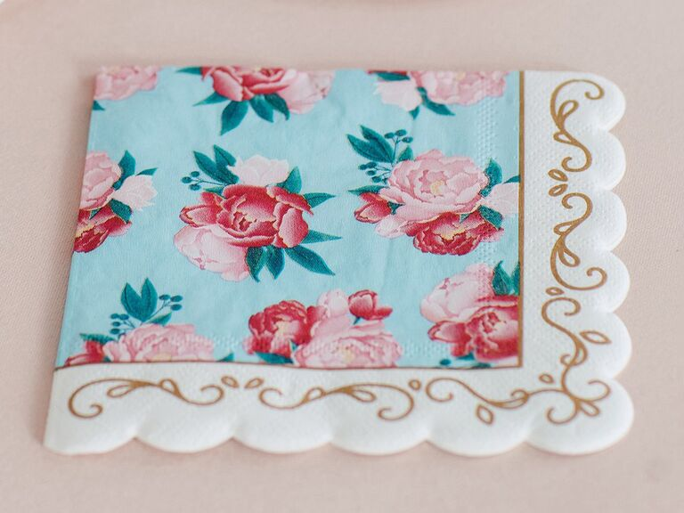 Napkins with baby blue background, pink florals. gold details, scalloped edges