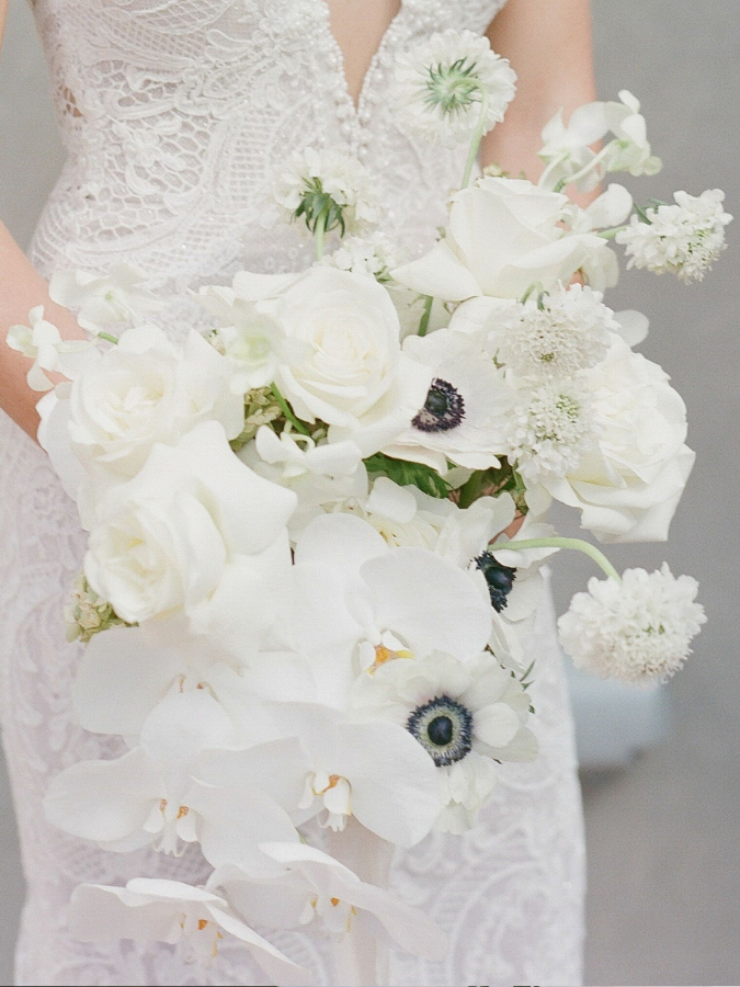White bouquet with anemone and orchid