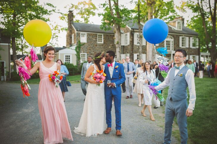 Eleanor and Kevin wanted their wedding to be a reflection of themselves—joyful and easygoing. Bohemian-inspired details and a bold color scheme, from