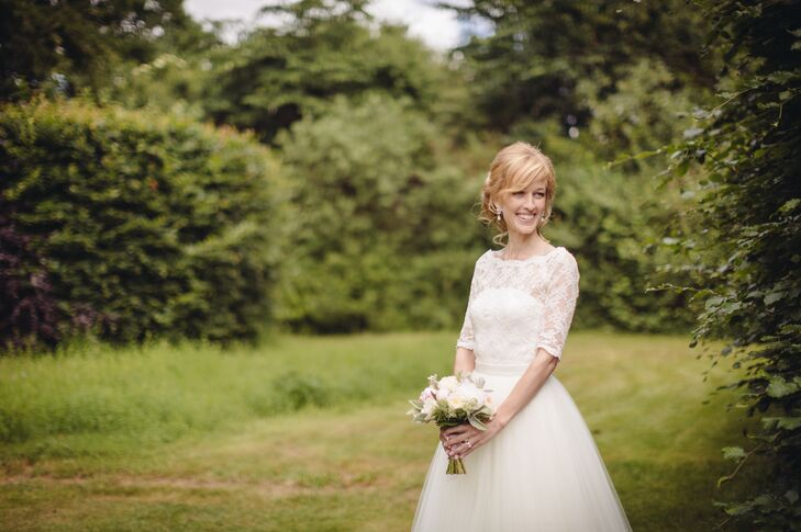 Linda wore a lace wedding dress with an illusion neckline and three-quarter sleeves. The dress featured a detachable tulle skirt. To showcase its pretty details, she styled her hair in a relaxed updo.