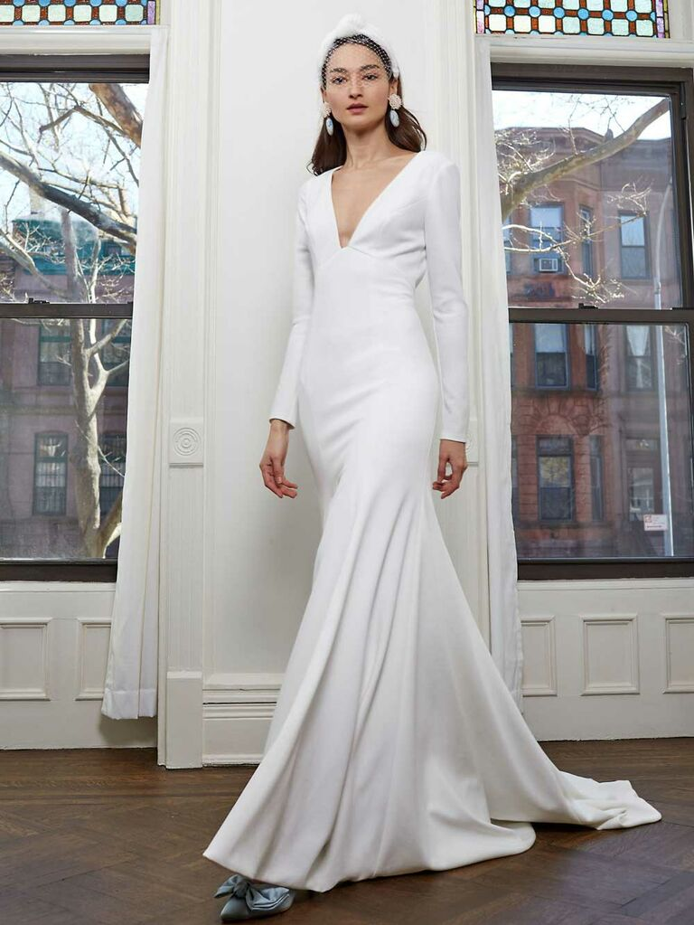 Simple long sleeve wedding dress with plunging neckline and keyhole open back