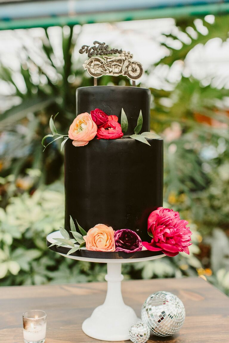 Two-tier black wedding cake with motorcycle cake topper