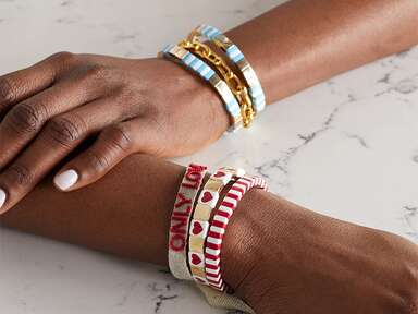 Gold and canvas beaded bracelets that spell out 'Only love'