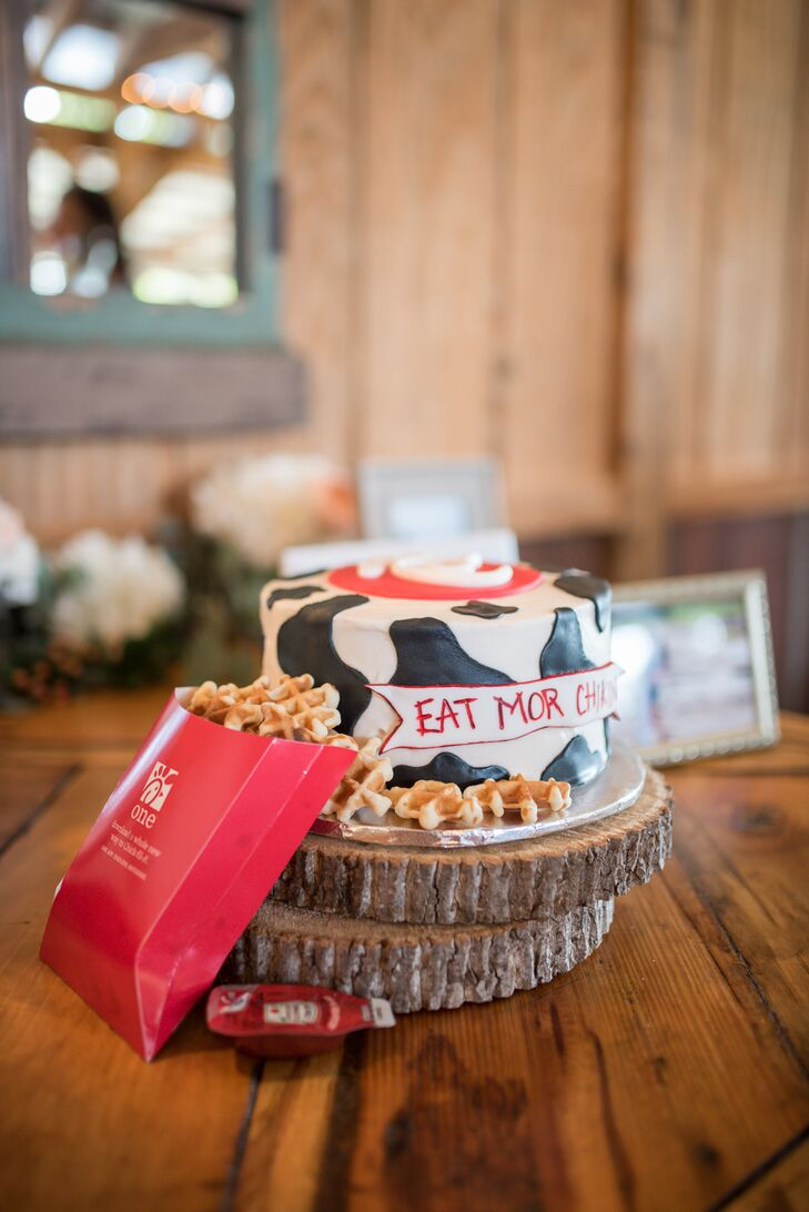"""During the reception, Morgan surprised Park with """"his favorite thing in the world"""": Chick-fil-A. Morgan had his groom's cake decorated in a cow print with a Chick-fil-A logo and waffle-fry cookies."""