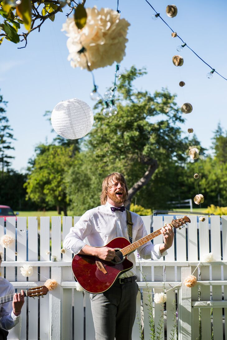 Groom Playing Music During Cocktail Hour