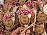 Mini bouquet magnets with pink wildflowers and kraft paper tag with wreath border and names