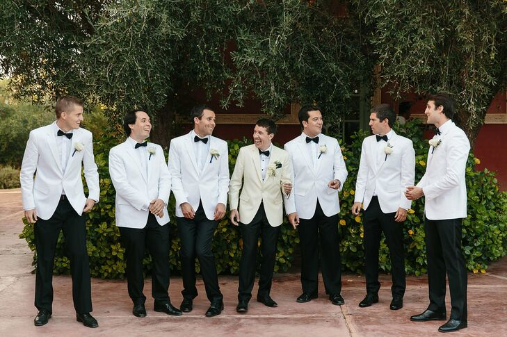 """Jacques was inspired by Humphrey Bogart in Casablanca for his wedding day look, opting for a classic white tuxedo jacket, black trousers and a black bow tie for his walk down the aisle. """"It was an added bonus that my dad wore a white tuxedo jacket in my parents' wedding in 1984,"""" Lauren says. The groomsmen also sported white jackets."""