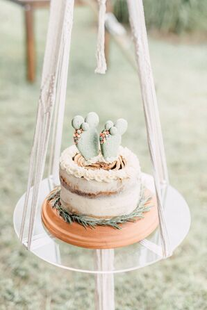 Single-Tier Wedding Cake With Cactus Topper on Swing