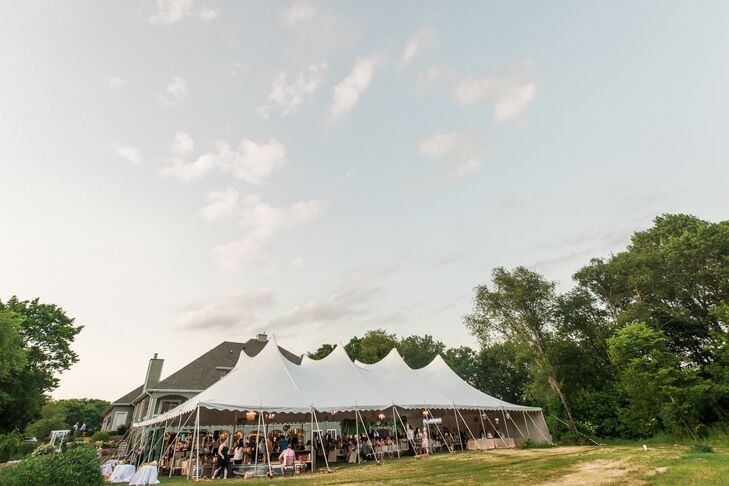 The tent was transformed with candles, twinkling lights and a black-and-white dance floor with a vintage chandelier.