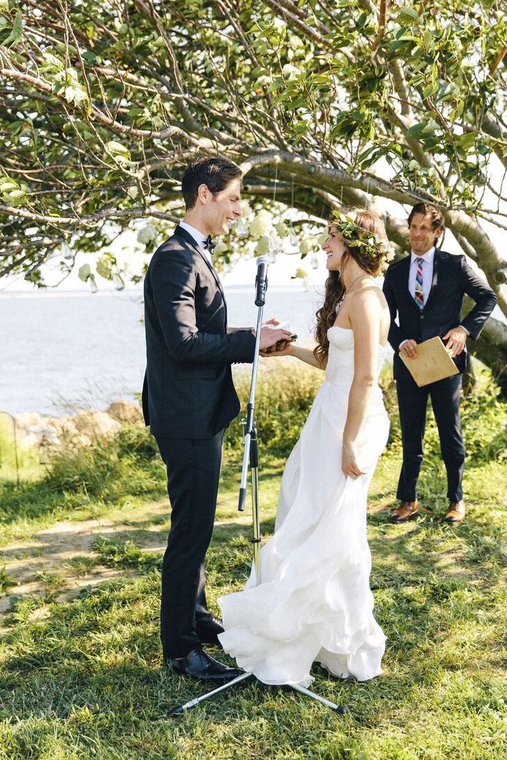 The bride and groom walked down the aisle together and wrote their own vows for their relaxed, backyard ceremony.