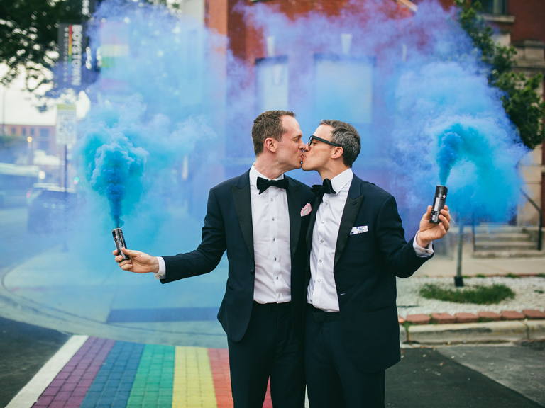 how to choose a wedding photography couple kissing with smoke cans