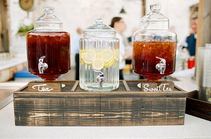 Beverage dispensers of lemon-infused water and iced tea were placed at a casual self-serve station.