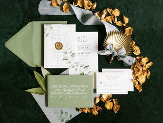 gold and green wedding invitation suite