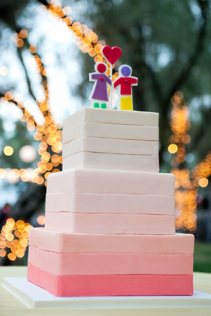 """The whimsical cake topper was one of the day's most meaningful details. The stick boy and girl holding a heart originally appeared on a card Deanna gave Dan while they were dating. Dan then used the same image in his proposal. """"We knew that it was really important, and we wanted that to be our cake topper,"""" Deanna says."""