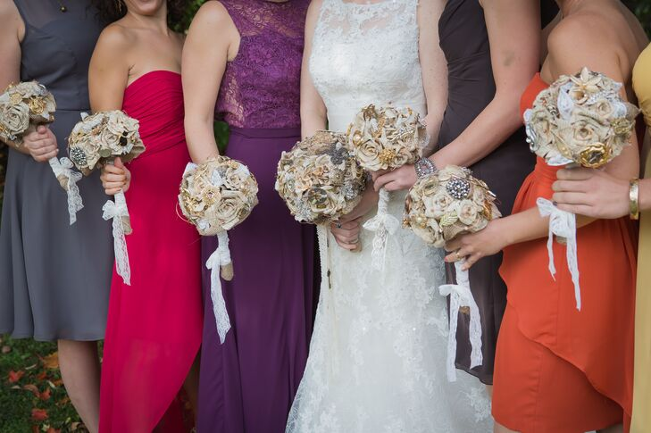 Erin-Joy made the bouquets with vintage brooches, roses folded from old book pages, burlap and lace.