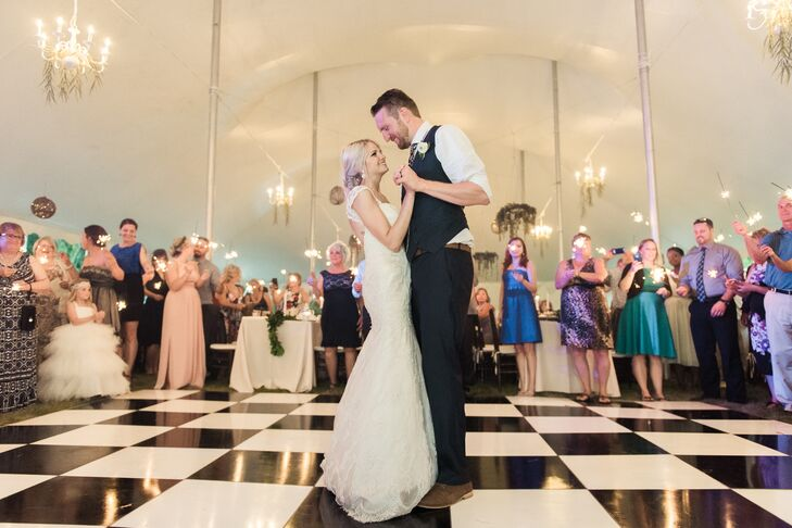 """The couple's first dance was to """"I Don't Dance"""" by Lee Brice. Guests waved sparklers around the perimeter of the dance floor."""