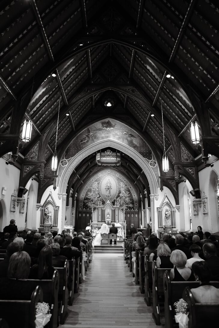 Since Brad's alma mater is Seton Hall University, and and Michelle wanted to take advantage of the school's gorgeous chapel. The church's Gothic vaulted ceilings and elaborate artistry served as their main decor. Michelle and Brad highlighted the space with only a few bunches of baby's breath along the aisle and two arrangements by the altar.