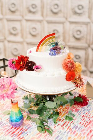 Two-Tier White Wedding Cake With Rainbow Topper