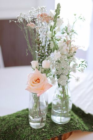 Simple Bottle Centerpiece With Roses on Moss