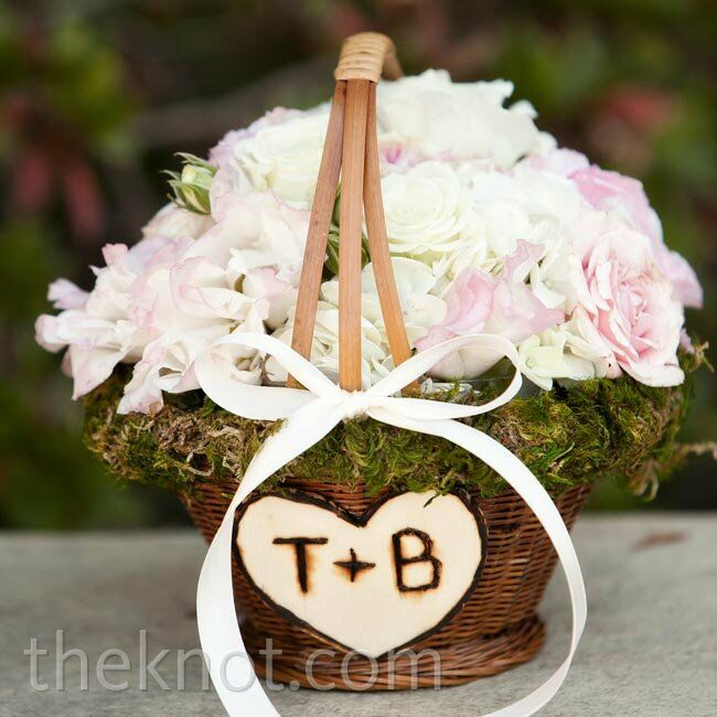 A moss-lined basket was filled with ivory lisianthus and pale-pink stock for the flower girl to carry.
