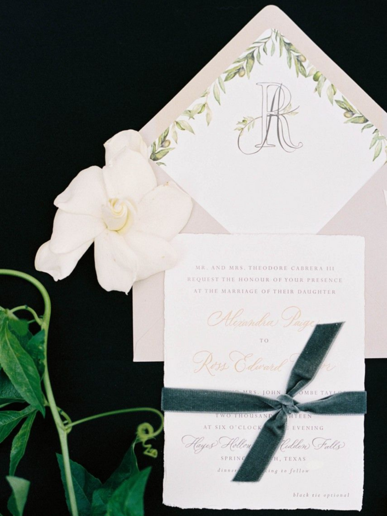 Invitation flat lay styled with gardenia bloom