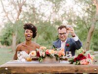 Couple raising toasts after wedding reception speeches.