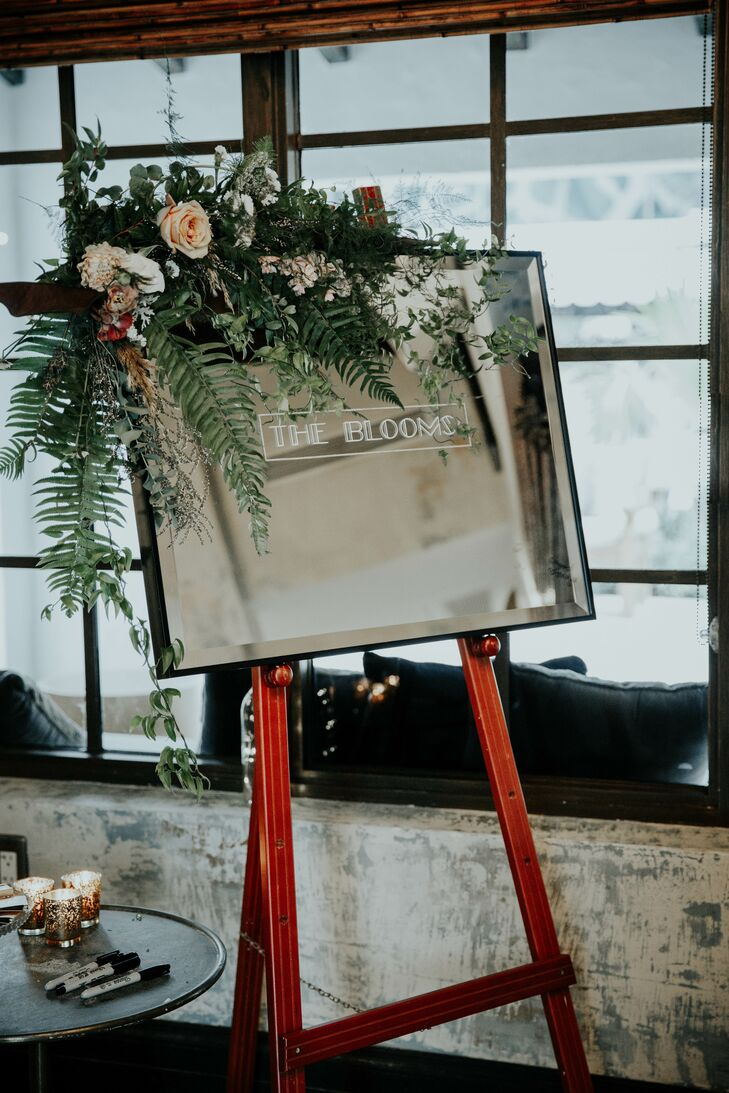 Sign on Easel with Tropical Flowers and Art Deco Typography
