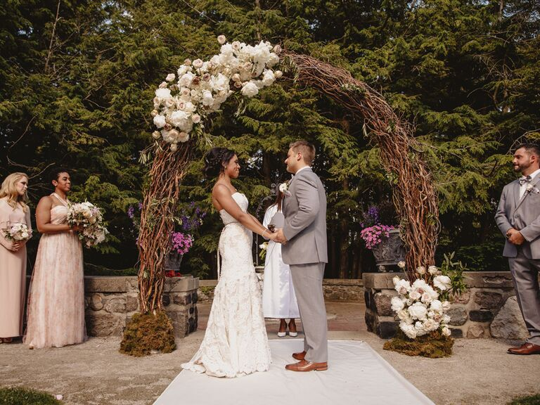 Couple saying vows during wedding ceremony