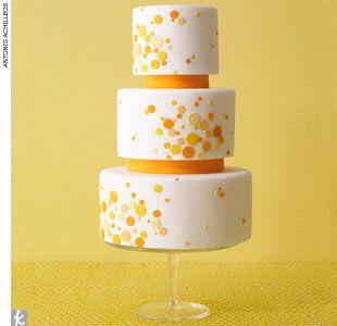 Yellow and white polka dot wedding cake