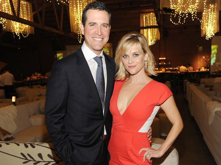 Reese Witherspoon and Jim Toth pose together at an event