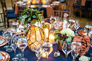 Reception Tables with Navy Blue Linens and Geometric Copper Accents