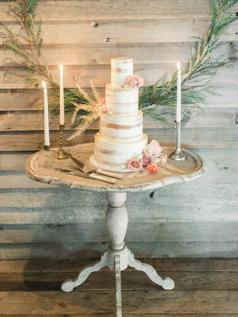 Semi-naked cake on rustic cake table