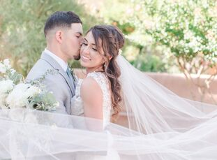 Kelly Barela and Anthony Rivera balanced their venue's natural vibe with a soft color palette of pale blue, gray and gold and understated vintage touc