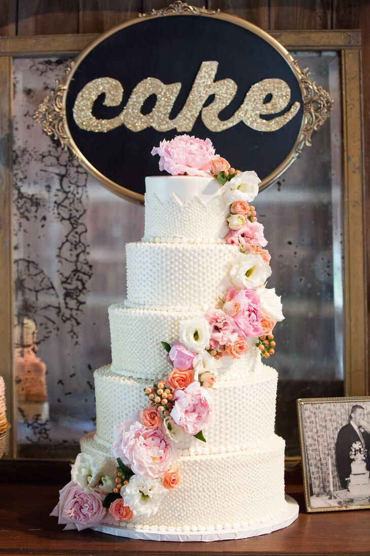 """Erin made sure her husband's specific cake tastes were highlighted in the five-tier dessert created by the Second Floor Bakery. """"John loves boxed cake mix, so we had the top Funfetti-flavored tier made just for him,"""" she explains."""