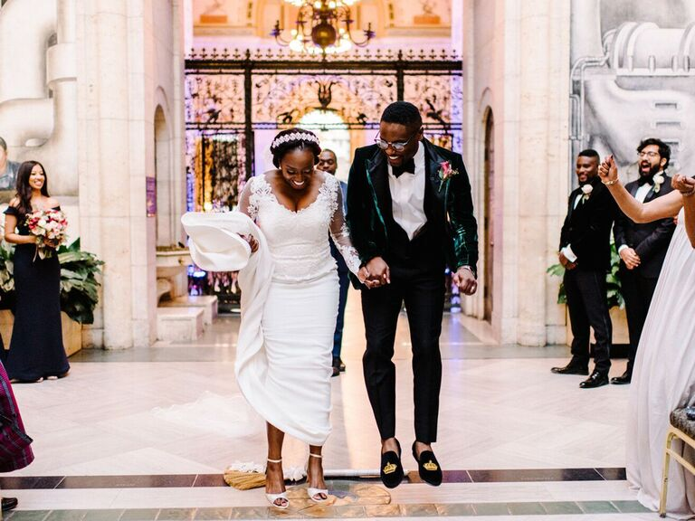 Bride and groom jumping the broom after wedding ceremony