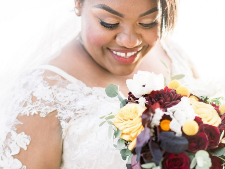 Bride wearing tiara and holding fall wedding bouquet