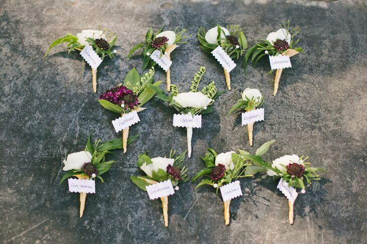 Michael Daigian Designs created an element of cohesion between the bridesmaids and groomsmen's looks through florals. The rich purple scabiosas and bright white roses in the guys' boutonnieres played off the bridesmaids' bouquets.