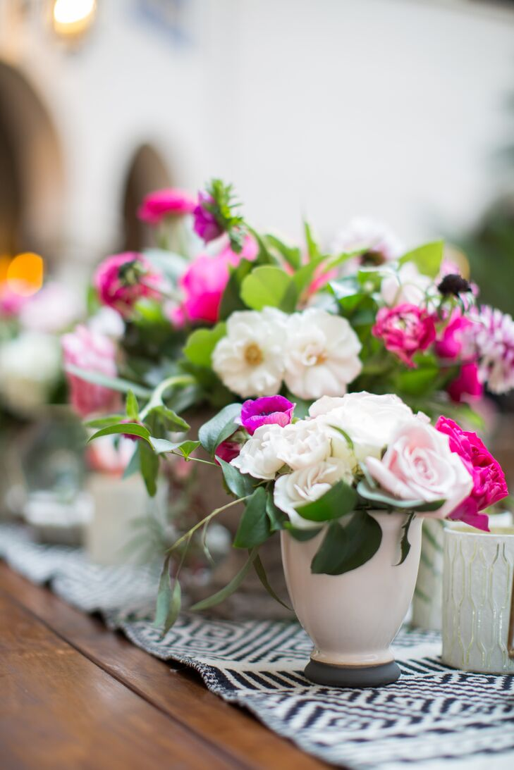 Tables were topped with arrangements of peonies, roses, dahlias and ranunculus in shades of pink.