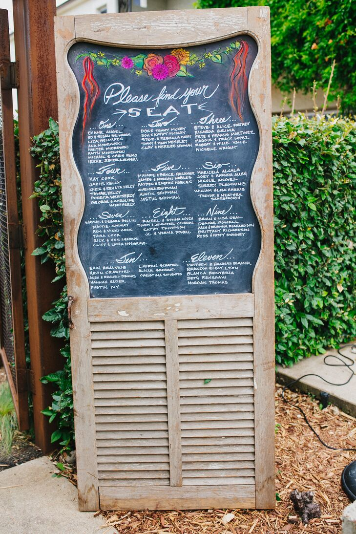 The seating chart was carefully etched on a chalkboard and displayed on a wooden door for the reception at the Belmont Hotel in Dallas, Texas.