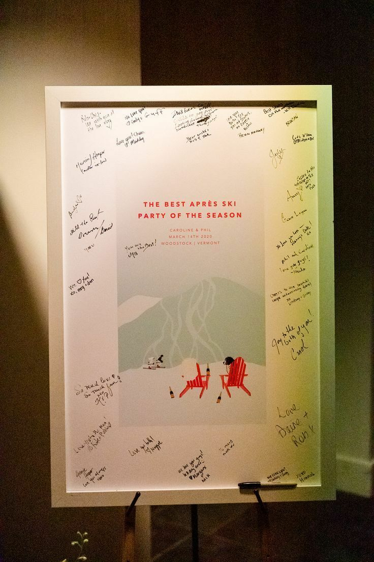 Ski-themed guest book sign on easel