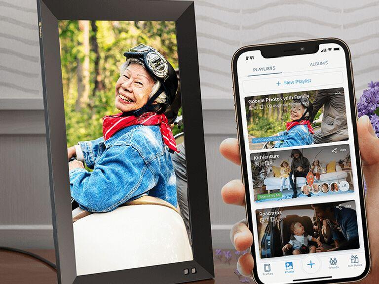 Sleek black digital picture frame showing picture of older woman smiling