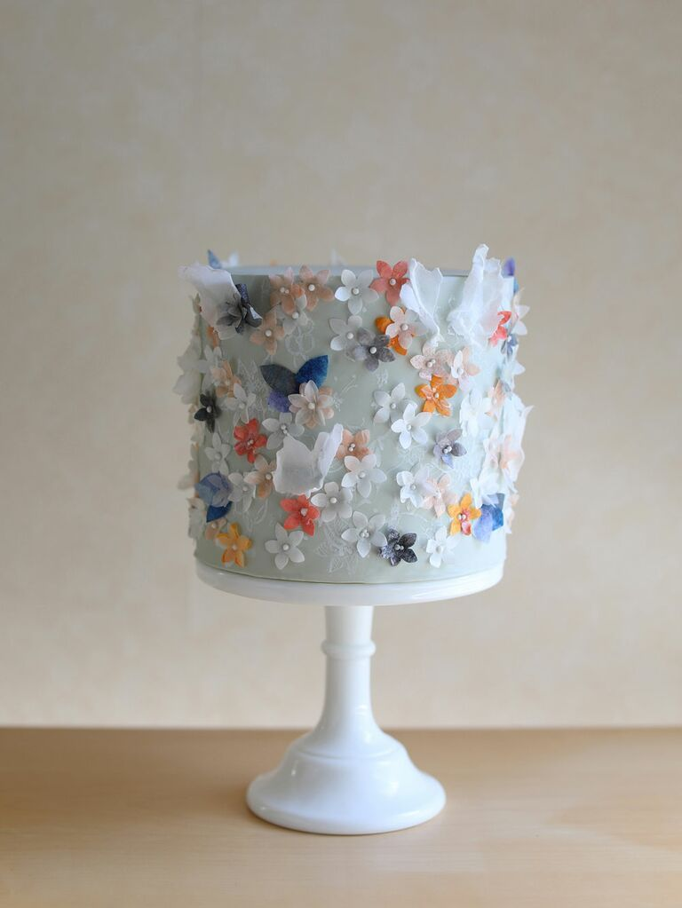Small one-tier blue bridal shower cake with floral appliqués