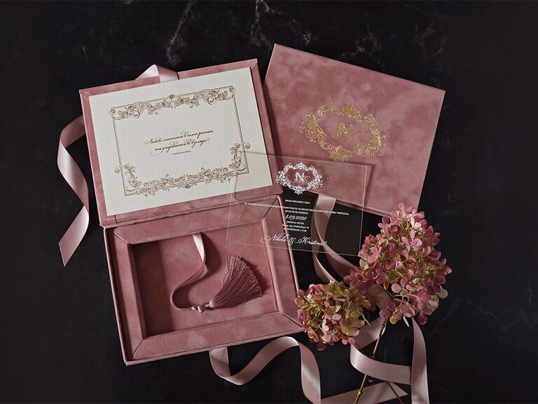 Mauve velvet box with acrylic cover and gold foil imprint, event details in elegant type