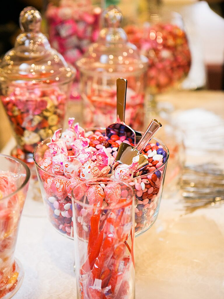 Colorful candy bar dessert station for a wedding reception