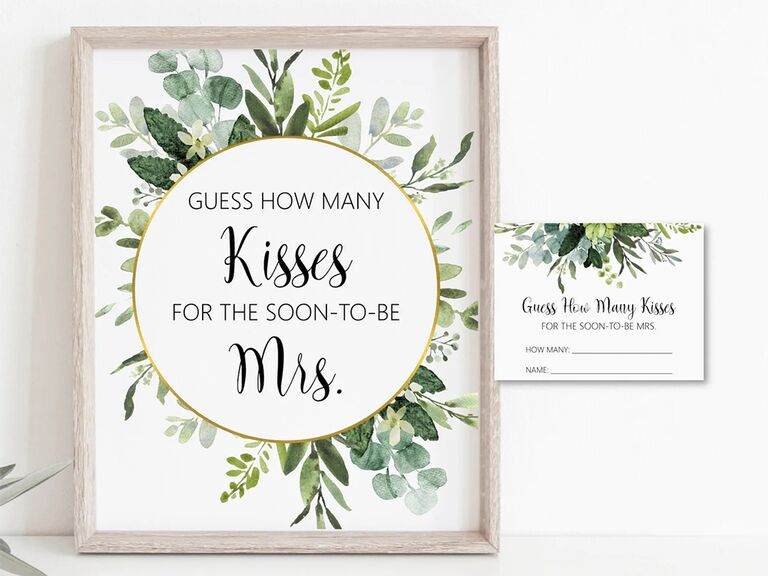 'Guess how many kisses for the soon to be Mrs.' print with greenery details on gold ring