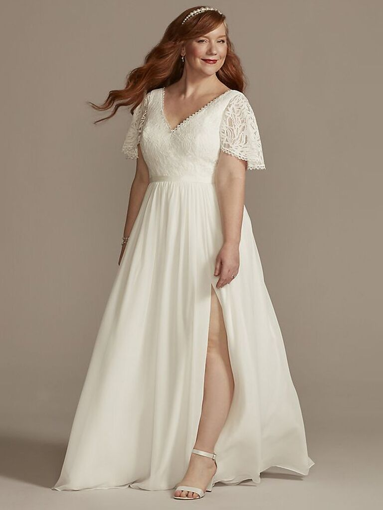david's bridal white a line wedding dress with short flutter lace sleeves v-neckline and flowy skirt with slit