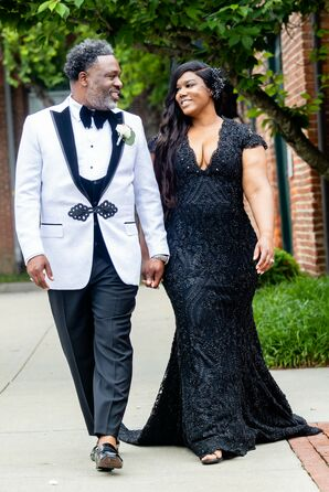 Bride in Black Wedding Dress and Groom in Black-and-White Tuxedo in Baltimore, Maryland