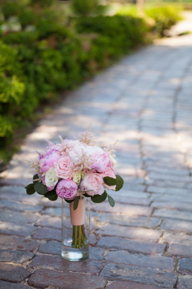 """Erin went in search of 'something old' to complement the pink peonies and garden roses in her bridal bouquet. """"I found a piece of blush velvet from the 1920s on Etsy which I used to wrap around the stem of my bouquet for a vintage touch,"""" she says."""